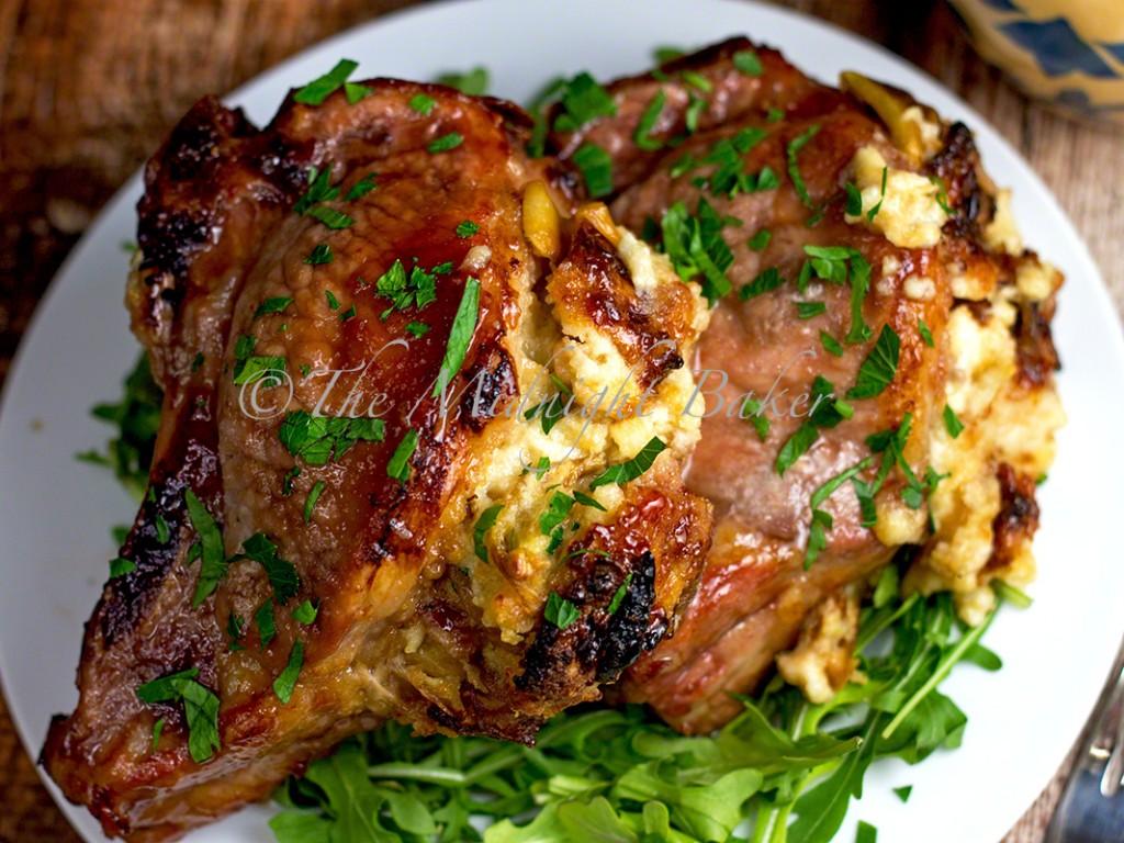 Fontina & Caramelized Onion Stuffed Pork Chops | bakeatmidnite.com | #porkchops #fontina #caramelizedonions