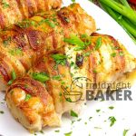 Chicken breasts wrapped in bacon and stuffed with a flavorful vegetable cream cheese.