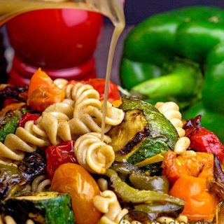 Whole wheat pasta salad full of roasted bell peppers and other veggies with a balsamic dressing to die for!