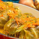 Cabbage leaves with a savory filling are sure to please. Top it off with a delicate tomato cream sauce.